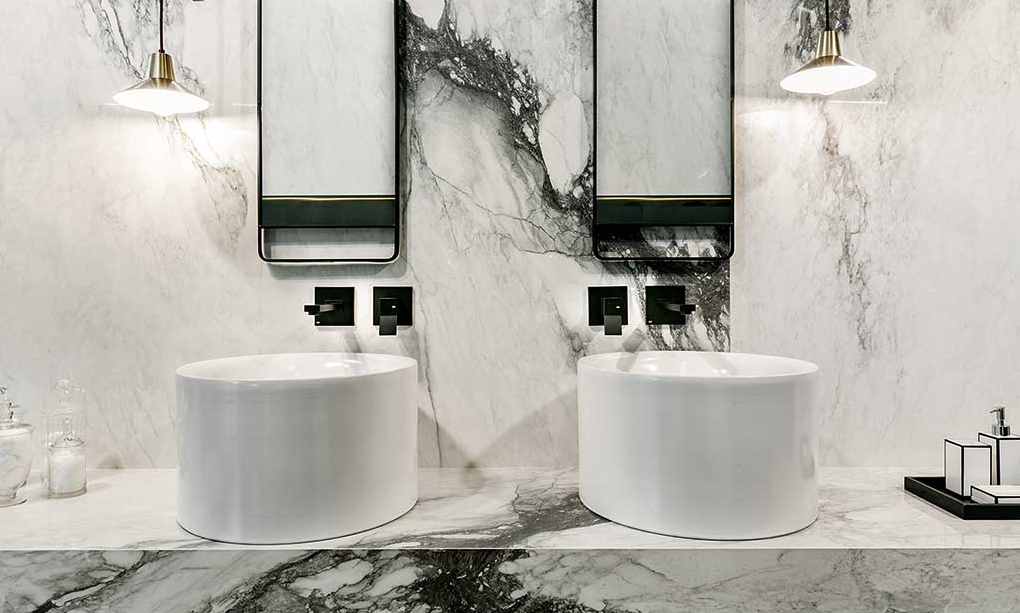 beautiful white marble bathroom with two round sinks